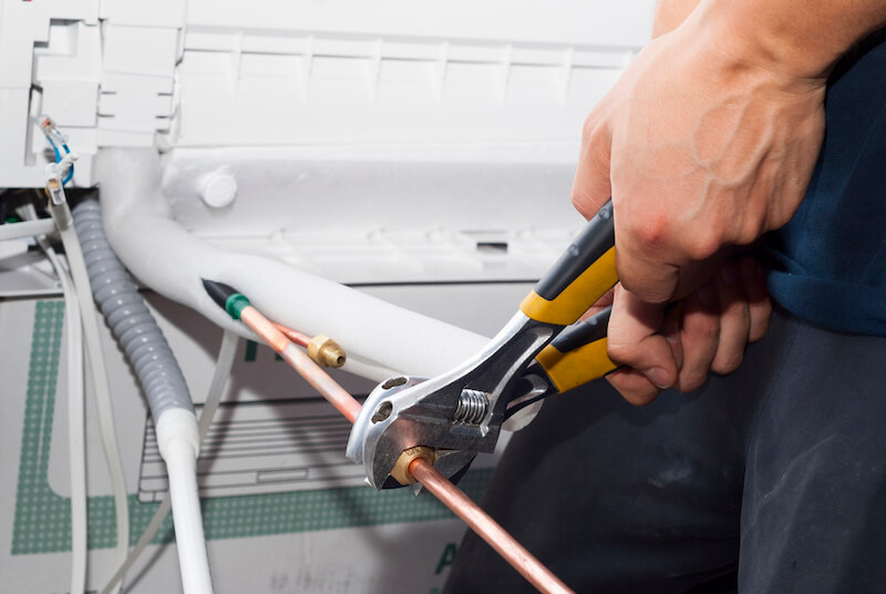 ac repair with wrenches