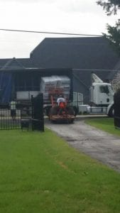 tractor loading semi truck with insulation