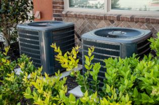 two hvac systems outside of a house