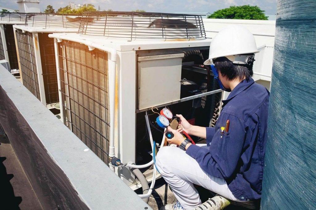 HVAC technician running maintenance