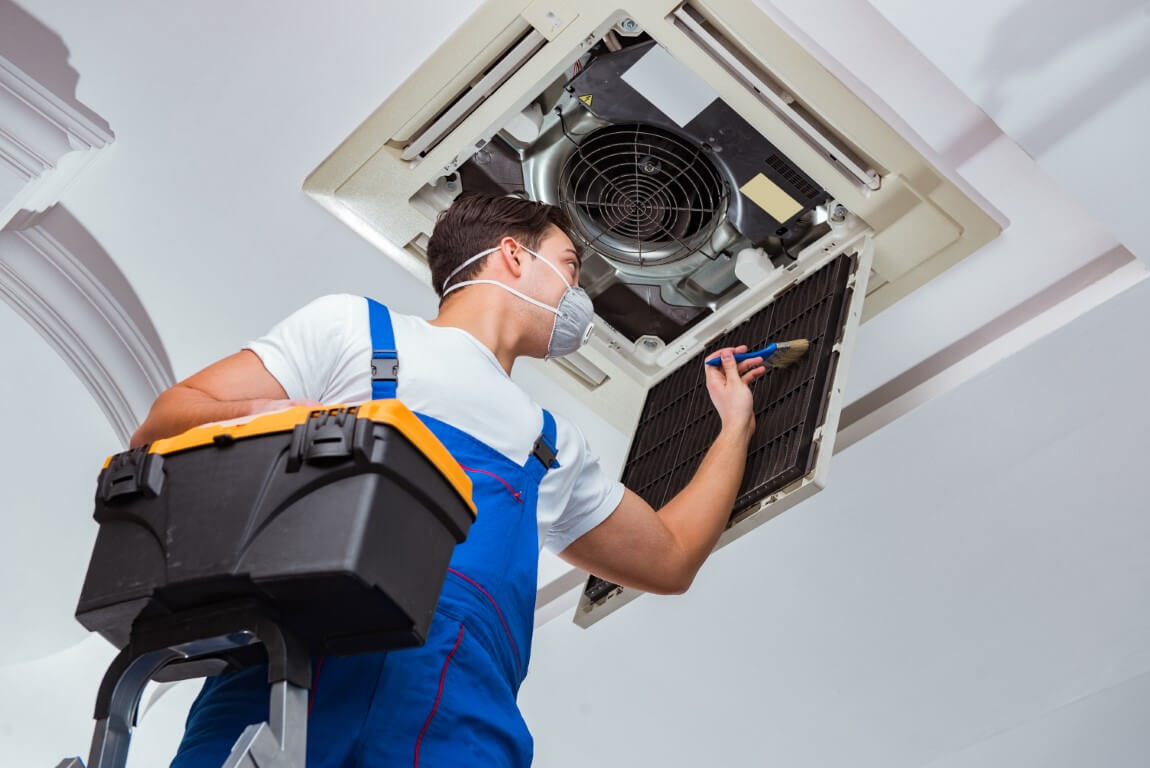 hvac technician cleaning vents